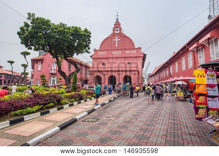 MALACCA, MALAYSIA - AUGUST 21, 2016 : Fountain and Christ Church near by Dutch Square in Malacca, The World Heritage City, Malaysia.