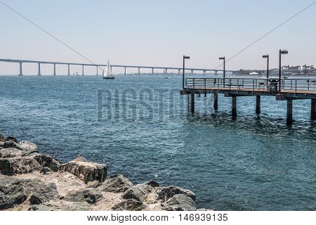 Fishing pier at Embarcadero Park South in San Diego, California, with the Coronado Bridge in the background.