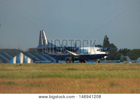 Kiev Region Ukraine - June 9 2011: Antonov An-12 cargo plane is taking off from the airport in the evening