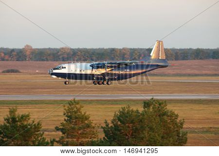 Kiev Region Ukraine - October 23 2011: Antonov An-12 cargo plane is landing in the airport on sunset