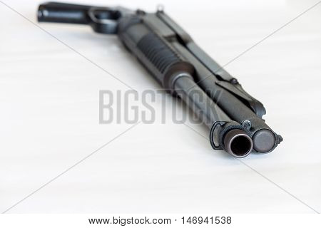 pump action shotgun isolated on white background