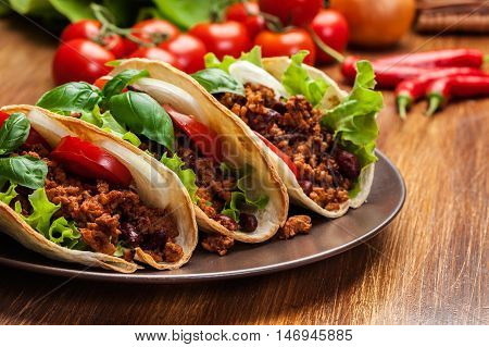 Mexican Tacos With Minced Meat, Beans And Spices