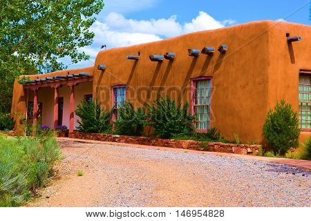 Historic style adobe building surrounded by a garden taken in Santa Fe, NM