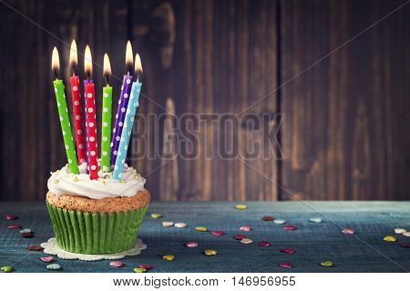 Cupcake with colorful birthday candle