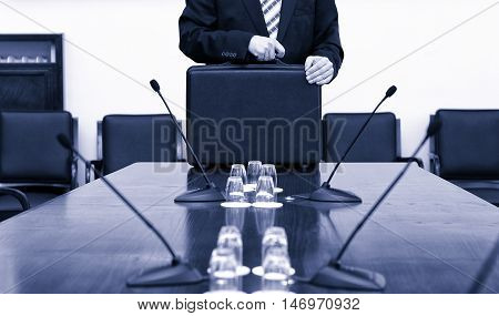Businessman In Suit Holding His Briefcase at the start of business meeting business meeting concept.