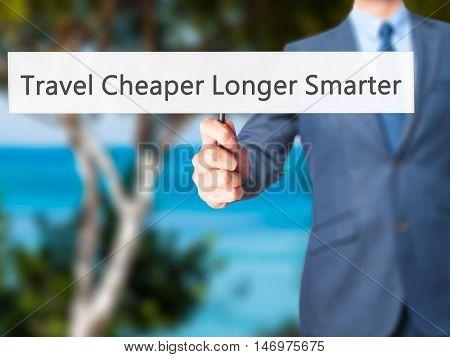 Travel Cheaper Longer Smarter - Businessman Hand Holding Sign
