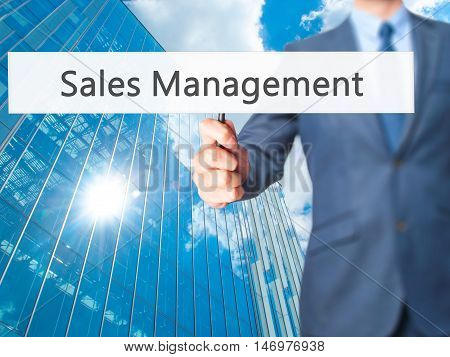 Sales Management - Businessman Hand Holding Sign