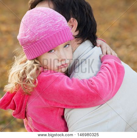 Dad pitying daughter. Sad child with father