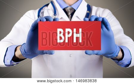 Doctor's hands in blue gloves shows the word BPH (benign prostatic hyperplasia). Medical concept.