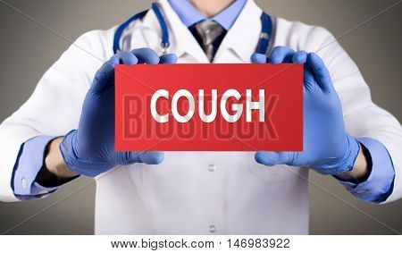 Doctor's hands in blue gloves shows the word cough. Medical concept.