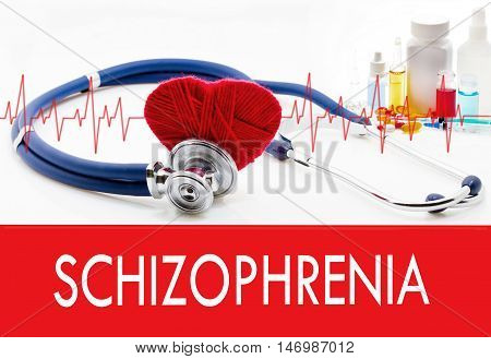 Medical concept schizophrenia. Stethoscope and red heart on a white background