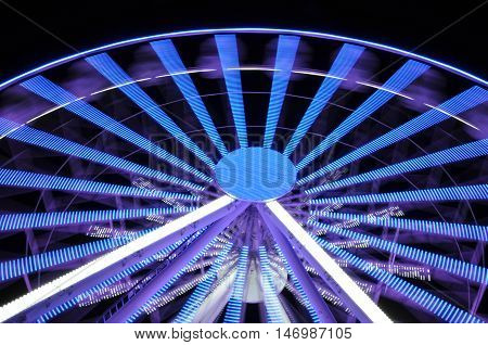 Spinning ferris big wheel at night light