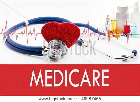 Medical concept medicare. Stethoscope and red heart on a white background