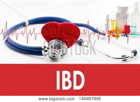 Medical concept IBD (inflammatory bowel disease). Stethoscope and red heart on a white background