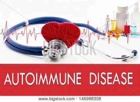 Medical concept autoimmune disease. Stethoscope and red heart on a white background