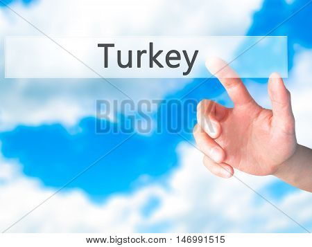 Turkey - Hand Pressing A Button On Blurred Background Concept On Visual Screen.