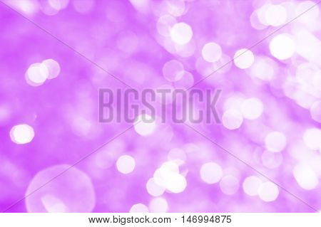 Abstract lilac background with white bokeh and patches of light