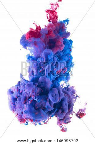 Abstract artistic photograph of Liquid Colors drop mixing under water. Colorful blend of water colors.  Isolated on white background. Magenta, blue and violet color mix.