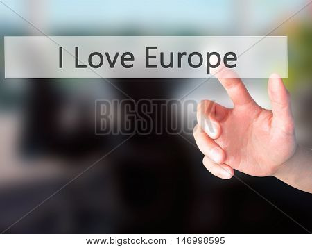 I Love Europe - Hand Pressing A Button On Blurred Background Concept On Visual Screen.