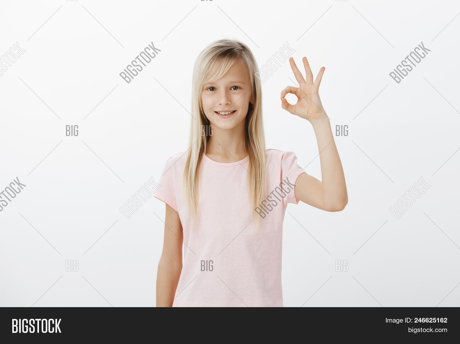 480652e54a1bc She got everything under control. Shot of confident adorable little girl  with blond hair, raising hand and showing ok sign, smiling broadly, liking  idea or ...
