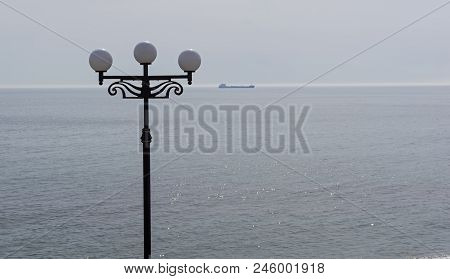 Lamppost On The Background Of The Sea. Crimea, Spring, Early April.