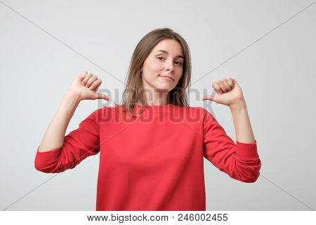 Young Pretty Woman In Red Sweater Proud And Confident, Pointing Fingers, Example To Follow. Concept