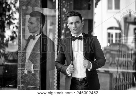 Man In A Tuxedo. Young Man Wears Suit And Bow Tie With Confidence. Confident Businessman.