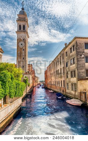 Venice, Italy - April 29:  Scenic Architecture Along The Canal Rio Dei Greci And The Leaning Bell To