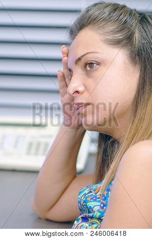 Close-up Of An Office Worker. A Lonely Young Woman, She Is Depressed And Separated From Problems In