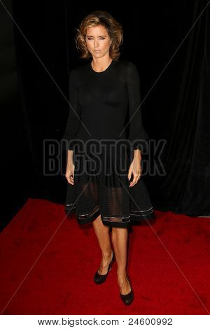 """NEW YORK - OCTOBER 24: Tea Leoni attends the premiere of """"Tower Heist"""" at the Ziegfeld Theatre on October 24, 2011 in New York City."""