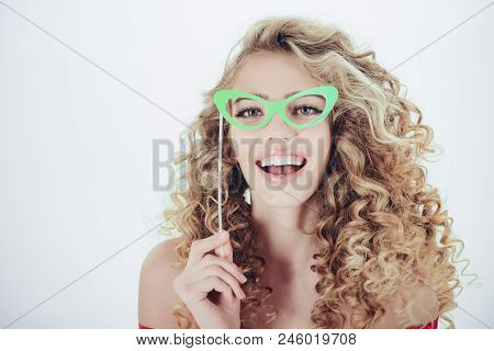 Woman With Curly Hair. Portrait Of Funny Positive Girl With Curly Hair In Paper Glasses. Makeup And