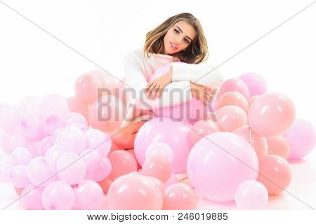 Balloon. Balloon Party. Girl In White Sweater Sits In Balloons. Trendy Young Woman Laying Between Pi