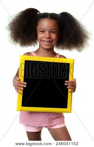 Cute african american girl holding a blank blackboard with space for text - Isolated on white