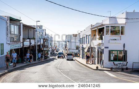 Puerto Del Carmen, Spain - December 24, 2016: Street View With Tourists And Atlantic Ocean In Puerto