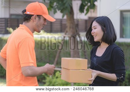 Happy Woman Receiving A Delivery Box From Delivery Man