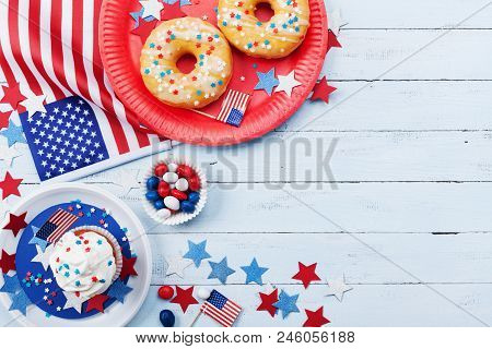 Fourth Of July American Independence Day Background Decorated With Usa Flag, Donut With Candys, Star