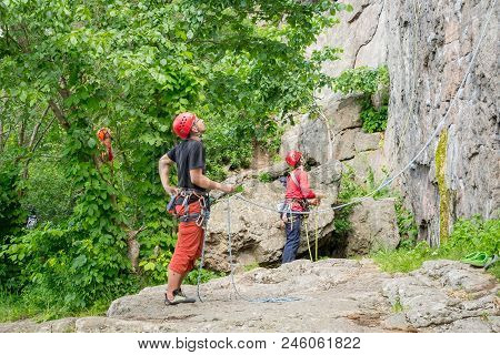 Yuzhnoukrainsk, Ukraine - June 19, 2018: Rock Climbing. Young Athletes Insure Their Comrades Climbin