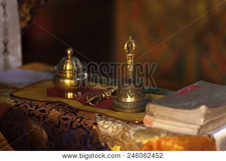 Ritual hand bell and dorje in the Buddhist temple as the enlightenment symbol. poster