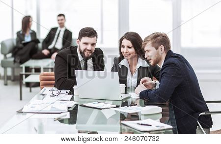 Business Team Working On Laptop And Making The Current Financial Report Sitting At Your Desk In The
