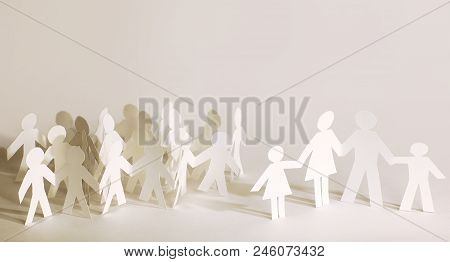 Many Paper Men On The Paper Background.business Background