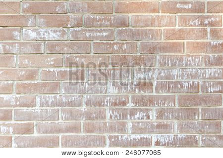 Wall Of A New Brown Brick. Heterogeneous Color