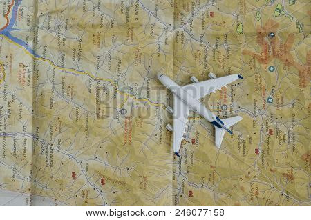 Kharkov, Ukraine- 13 April 2018: Airplane On The Map. Travel Concept. Close Up