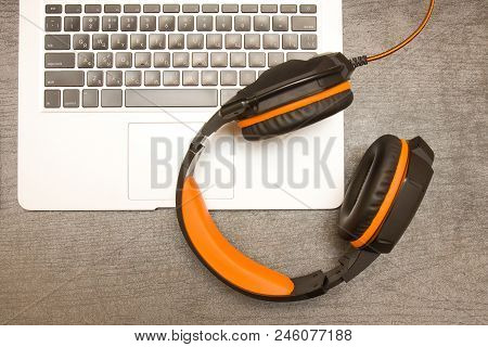 Laptop Keyboard And Headphones. Workplace. Top View