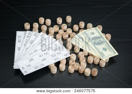 Wooden Barrels Lotto, Cards And Dollars. Black Wooden Table.
