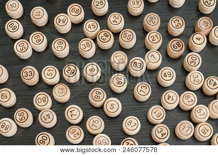 Many Wooden Barrels Of Lotto On Black Background.