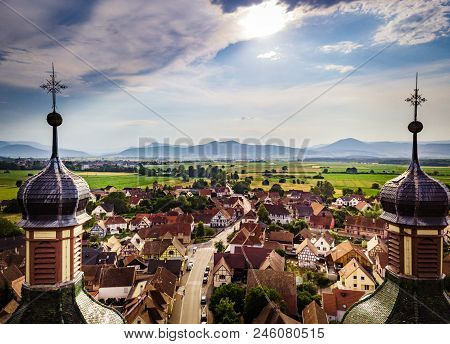 Soaring majestic church Saint Maurice in little french village Ebersmunster. Aerial drone view. Alsace. France. poster