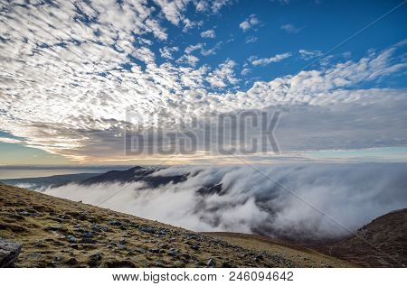 A Gorgeous Sunset View From Slieve Donard With Low Lying Clouds.