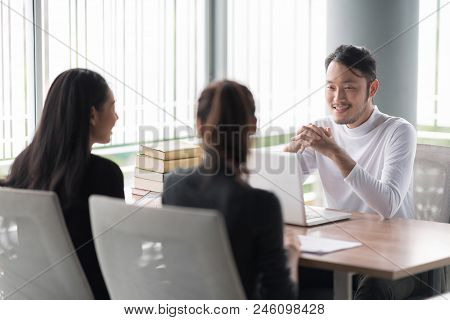 Smiling Businessman During Job Interview.job Interview Concept.businessman Explaining And Listen To