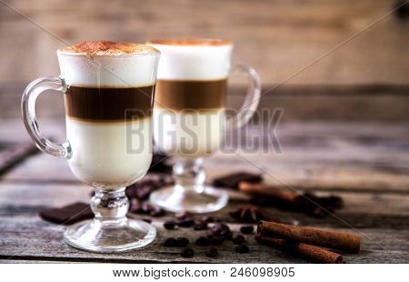 Coffee In Glass On The Wooden Background A