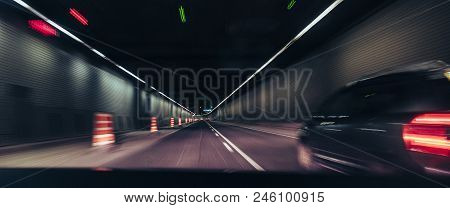 Long Exposure Photograph Taken From A Moving Car Entering A Tunel